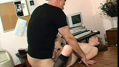Lovely blonde lies on the desk and gets her tight holes pounded deep
