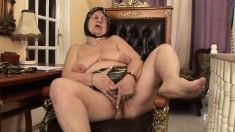 Naughty fat grandma working on the cock of a huge tattooed stud