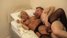 Naughty mature lady in black lingerie gets her fiery peach fucked hard on the bed