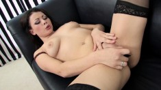 Sexy babe in stockings Karmella Sutra makes herself cum with a dildo