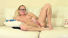 The hot blonde Nikki gently rubs her nipples and sticks a blue dildo in her pussy