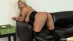 Curvaceous blonde bimbo bends over to show off her phat booty