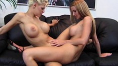 Gorgeous blonde bitches give each other a deep and mean fingering