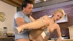Nasty blonde housewife Nicole gets her ass fucked rough in the kitchen