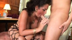 Wild brunette takes her lover's pulsating piston in her mouth
