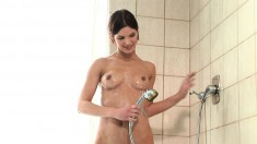 Gorgeous brunette showing off the contours of her body in the shower
