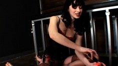 Cruel brunette mistress Mina tramples on a bound slave's poor cock