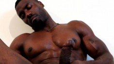 Attractive dark skinned hunk shows off his ripped body and masturbates