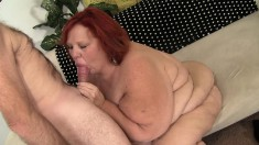 Fat redhead mature has a horny guy giving her the fuck she deserves