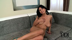 Slowly dropping her clothes, she reveals her adorable tits, hot ass and shaved cunt
