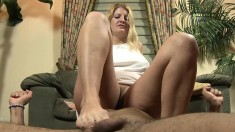 Provocative Blonde Cougar Robbie Sends Her Feet Pleasing A Long Shaft