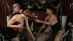 Nasty Mistresses Get Together To Shove Stuff Up Their Slave's Ass