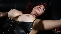 Lying on the couch, the hot cougar has him driving his big dick deep in her pussy