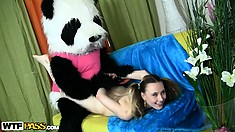 She puts the strap on dildo on her bear and he fucks her to orgasm