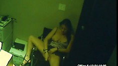 In the office, a horny secretary with a hot body is caught masturbating by a security cam
