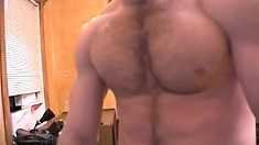 Muscular man with a nice happy trail strokes his big fat cock