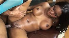 Curvy ebony broad glistening with oil gets her juicy body rocked