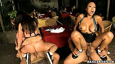 Two babes with fat butts ride up and down on big hard schlongs