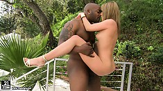 Blonde has the ride of her life on a big black cock outdoors