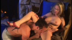 Stacked blonde has her husband eating out and drilling her pussy by the fireplace