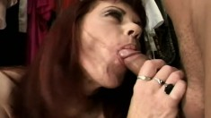 Serenity is a busty redheaded MILF eating cock and getting fucked in the closet