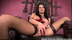 Gothic brunette in fish net stockings and a corset masturbates