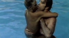 Busty brunette is in the pool naked and they go in for some passionate sex
