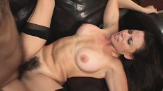 Big breasted brunette milf has a young man drilling her hairy snatch