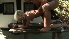 With her hands tied up, a submissive blonde enjoys a rough pounding