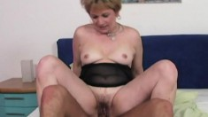 Slutty short-haired cougar is eager to taste this young dude's bone
