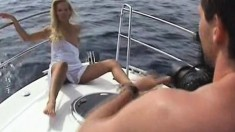 Delightful young blonde Sandy shows off her sexy slim body on a boat