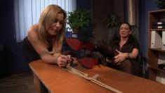 Slutty blonde secretary with big boobs explores her bondage fantasies