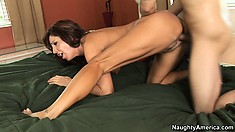 Tara Holiday is humped sweetly on broad green bed by well-endowed dude