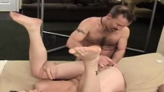Gay hotties in a threesome wearing leather and drilling their asses