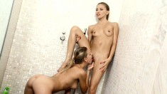 Two mesmerizing blondes explore their lesbian desires in the shower