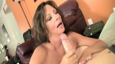 Attractive cougar Margo reveals her big boobs and her handjob talents