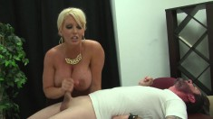 Big breasted blonde teacher offers a hung student a splendid handjob
