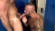 Muscled hunks engage in some exciting anal fucking in the locker room