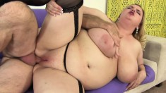 Fat blonde in black lingerie works her mouth and her pussy on a dick