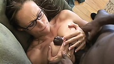 Milky white MILF, in glasses, gobbles up his giant black boner
