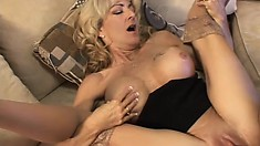 Busty blonde mom Lexi Carrington has a horny tattooed stud fucking her needy cunt