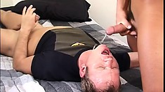 He suckles on his man's cock and strokes himself, then swallows his cum