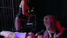 Lesbian mistress gives her naughty pet a lesson in discipline