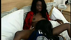 Insatiable ebony lesbian gives her tight muff up to her girlfriend