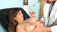 Big breasted babe gets a check up from her touchy-feely doctor