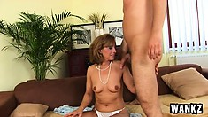 Lustful mature lady enjoys every thrust of the young stud's hard cock in her twat