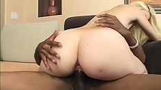 Skinny blonde with tiny boobs fully enjoys the pleasure a big black dick provides