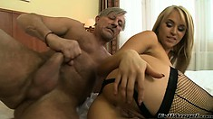 Blonde whore in fishnet stockings gets her ass fucked by an old man