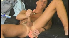 Jeff plugs his butt with a toy as he jerks his long hard member