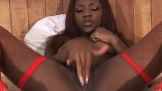 Slutty ebony babe in red fishnets Persia feeds her desire for black cock
